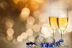 champagne against holiday lights ang christmas decorations - stock photo
