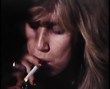 Various shots of people smoking, including close up of burning cigarette Stock Footage