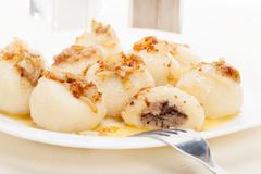 Meat stuffed dumplings with fried onion. selective focus Stock Photos