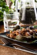 pork loin with mushroom sauce. dark light - stock photo