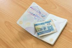 Lao pdr passport stamp with kip money Stock Photos