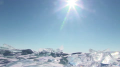 Ice on blue sky background - stock footage