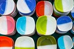 ceramic bowl with assorted designs. - stock photo
