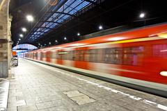 train im motion enters the station - stock photo