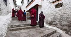 4k tibet monks walking on the lhasa drepung,famous tibetan temple. Stock Footage