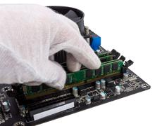 Electronic collection - installing memory module in dimm slot on motherboard Stock Photos