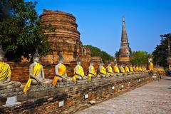 buddha statues at the temple of wat yai chai mongkol - stock photo