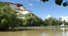 4k Potala in Lhasa,Tibet.lake with willow in lasa park. Stock Footage