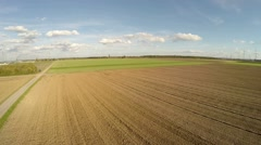 Aerial of harvesting a mais-field in germany Stock Footage