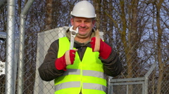 Happy worker with adjustable wrench  Stock Footage