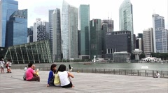 Singapore City Skyline, people, Financial district across Marina Bay Stock Footage