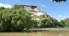 4k Potala in Lhasa,Tibet.lake with willow in lasa park. Stock Footage