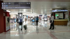 Timelapse of People in front of a Duty Free shop at Muscat International Airport Stock Footage