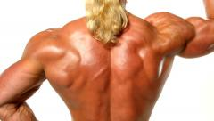 Very muscular back guy on white background Stock Footage