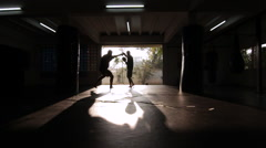 Fighters Muay Thai Boxing Training Silhouette Slow-Motion Gym Wide Stock Footage