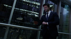 Stock Video Footage of Caucasian European business male night developer traveller technology tablet