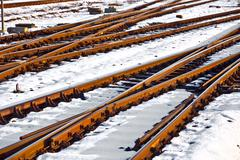 Rails in winter at the station Stock Photos