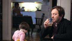 Stock Video Footage of Father ignore daughter Drinking Alcohol Family in the background