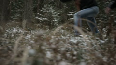 Two men running through the woods. Slow motion - stock footage