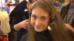 Slavic girl face close-up in hair saloon Stock Footage