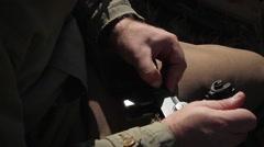 U.S. Sergeant inspects M1 Carbine Rifle   World War 2 Stock Footage