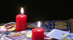Mystic Tarot Cards and Burning Candles Reading Future Stock Footage