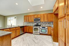 Luxury kitchen room with bright brown cabinets Stock Photos