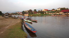 Boats in the Nam Song River in Vang Vieng, Vientiane Province, Laos Stock Footage