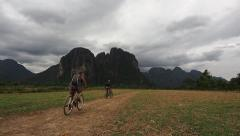 Tourists Cycling Around the Laotian Contryside, Vang Vieng, Laos Stock Footage