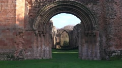Stone gothic archway entrance to old disused English stone abbey building Stock Footage