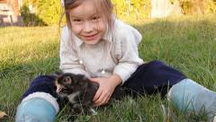 A girl and a kitten on the nature Stock Footage