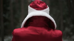 Santa Claus in forest smiling and laughing Stock Footage