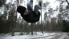 Man running through the woods and doing parkour jump. Slow motion Stock Footage