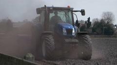 Blue Tractor in farmland Stock Footage