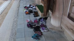 Shoes outside the temple Stock Footage