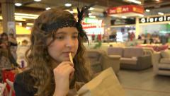 Girl school age eats french fries Stock Footage