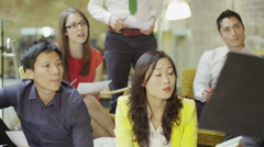 Mixed ethnicity business group brain storming in a meeting in modern office Stock Footage