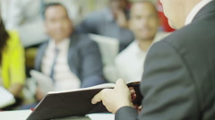 Mixed ethnicity business group brain storming in a meeting in modern office - stock footage
