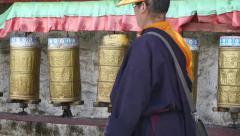 4k tibetan person turn spinning buddhist prayer wheels,lhasa. Stock Footage