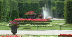 Flowerbed with fountain in park. Stock Footage