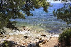 Clear water of the Aegean Sea. Stock Photos