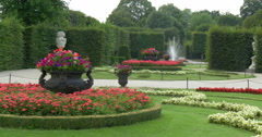 Flowerbed with fountain in park, Vienna. Stock Footage