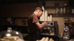 Worker of coffee shop making coffee for guests Stock Footage
