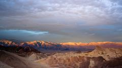 Sunrise badlands amargosa mountain range death valley zabriske point Stock Photos