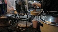 Street female vendor chops up chicken Stock Footage