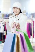 Girl giving shopping bags in the mall Stock Photos
