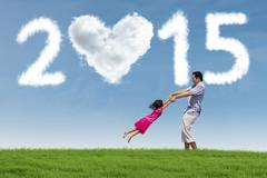 Girl having fun with her father in field Stock Illustration