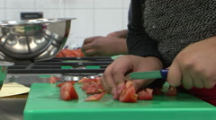 Tomato cutting horeca kitchen Stock Footage