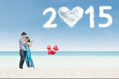 Lovers couple kissing on beach Stock Illustration