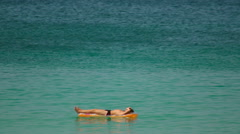 Sunbathes in ocean Stock Footage